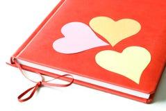 Três corações em um diário Imagem de Stock Royalty Free