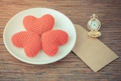 Três corações em uma placa Fotografia de Stock