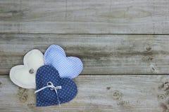 Três corações no fundo de madeira Fotografia de Stock Royalty Free