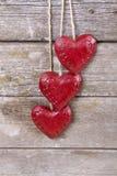 Três corações vermelhos de madeira Fotos de Stock Royalty Free