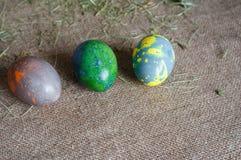 Três cores de mármore dos ovos para a Páscoa Imagens de Stock