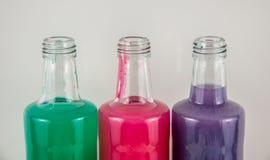 Três cores em umas garrafas, azul, vermelho, verde imagem de stock royalty free