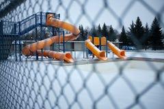 Três corrediças amarelas em um parque da água Foto de Stock