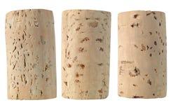 Três cortiça do vinho isoladas fotos de stock