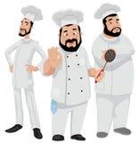 Três cozinheiros chefe Fotos de Stock