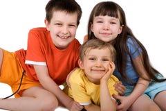 Três crianças felizes Fotografia de Stock Royalty Free
