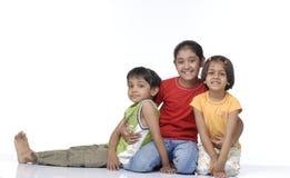 Três crianças felizes Fotos de Stock Royalty Free