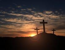 Três cruzes no por do sol Imagem de Stock Royalty Free