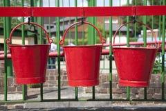 Três cubetas vermelhas Foto de Stock