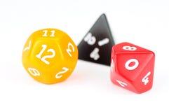 Três dados coloridos no branco Foto de Stock