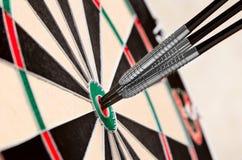 Três dardos no bullseye Foto de Stock Royalty Free