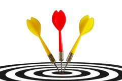 Três dardos que batem o meio do alvo Imagens de Stock Royalty Free