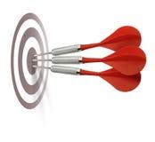 Três dardos vermelhos que batem o alvo Imagens de Stock