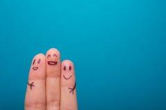 Três dedos de sorriso que estão muito felizes ser Fotos de Stock