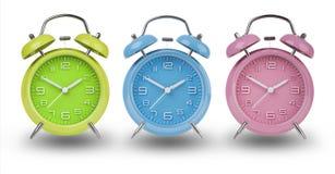 Três despertadores com as mãos em 10 e em 2 Imagem de Stock