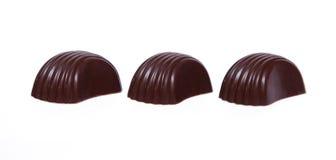 Três doces do chokolate Fotografia de Stock Royalty Free