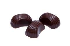 Três doces do chokolate fotos de stock