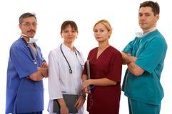 Três doutores e enfermeira Fotos de Stock Royalty Free