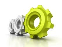 Três engrenagens da roda denteada com o líder verde no fundo branco Imagem de Stock