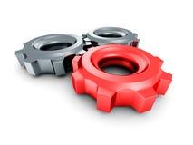 Três engrenagens da roda denteada com o líder vermelho no fundo branco Imagem de Stock