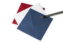 Três envelopes e um ballpoint fotos de stock royalty free