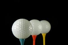 Três esferas de golfe fotografia de stock