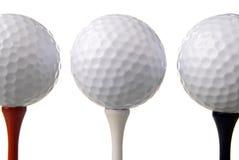 Três esferas de golfe em T fotos de stock