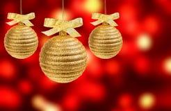 Três esferas douradas sobre o fundo abstrato foto de stock royalty free