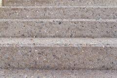 Três etapas de uma escadaria concreta cinzenta tomada da parte dianteira imagem de stock royalty free