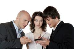 Três executivos da fala fotografia de stock royalty free