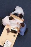 Três executivos de trabalho sobre cópias azuis Foto de Stock Royalty Free