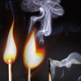 Três fósforos iluminados Fotografia de Stock