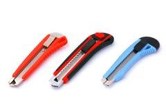 Três facas da caixa isoladas no branco Imagens de Stock