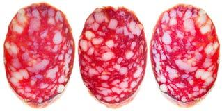 Três fatias de salsicha fumado isoladas Foto de Stock Royalty Free