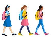 Três figuras isoladas das meninas que vão à escola Fotos de Stock