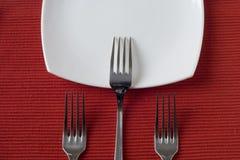Três forquilhas e placas da porcelana Foto de Stock Royalty Free