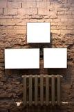 Três frames e radiadores vazios Imagens de Stock Royalty Free