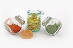 Três frascos com especiarias e ervas Fotografia de Stock