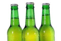 Três frascos de cerveja verdes Fotografia de Stock