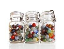 Três frascos dos mármores imagem de stock