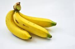 Três frutos da banana no fundo branco Imagens de Stock