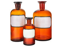 Três garrafas da farmácia do vintage foto de stock