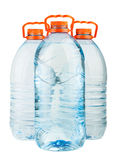 Três garrafas de água plásticas completas grandes com tampões alaranjados Fotografia de Stock