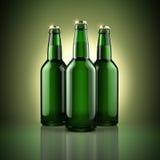 Três garrafas de cerveja Fotos de Stock Royalty Free