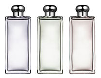 Três garrafas de vidro retangulares à moda Fotos de Stock
