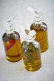 Três garrafas do azeite Imagem de Stock