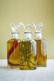 Três garrafas do azeite Imagens de Stock Royalty Free
