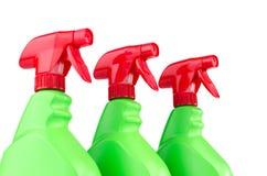 Três recipientes plásticos da garrafa do pulverizador isolados no fundo branco Imagens de Stock