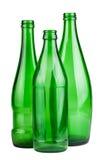 Três garrafas vazias verdes Fotografia de Stock Royalty Free