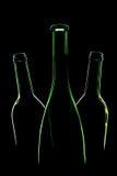 Três garrafas verdes vazias Fotos de Stock Royalty Free